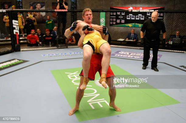 Team Canada fighter Sheldon Westcott takes down Team Australia fighter Daniel Kelly in their middleweight fight during filming of The Ultimate...