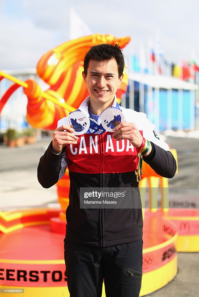 Team Canada figure skater Patrick Chan visits the McDonald's Cheers to Sochi Kiosk in the Athlete Village to read good luck messages sent from fans during the 2014 Sochi Winter Olympics on February 19, 2014 in Sochi, Russia.