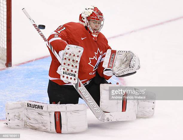 TORONTO ON DECEMBER 30 Team Canada goalie Genevieve Lacasse makes a save against Team United States during second period exhibition Women's Hockey at...