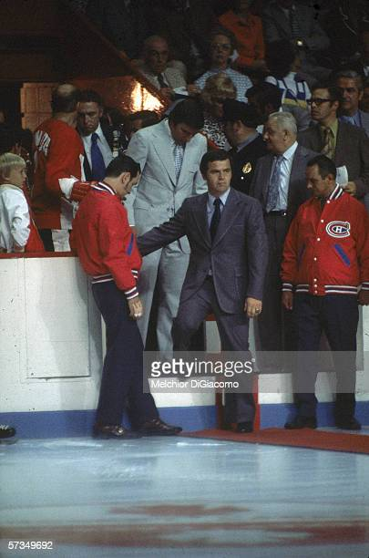 Team Canada head coach and general manager Harry Sinden steps onto the ice at the 1972 Summit Series September 1972