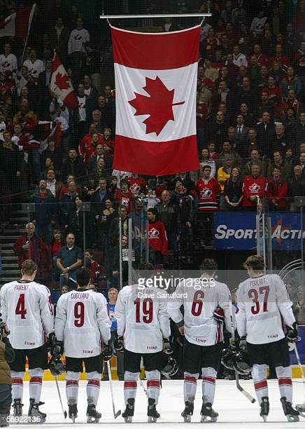 Team Canada line up at center ice for the raising of their national flag after prior to taking on Team Finland in their World Junior Hockey...
