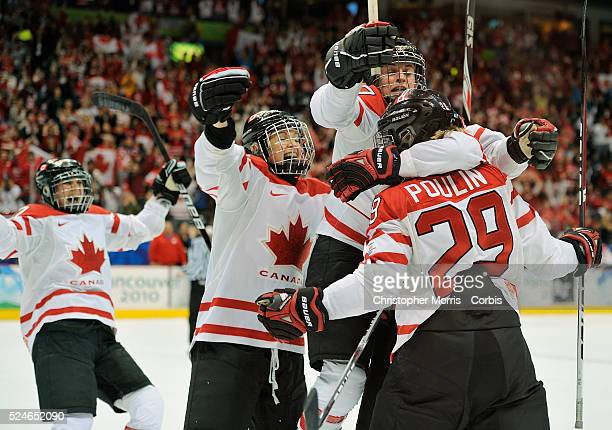 Team Canada members celebrate their first goal en-route to beating The United States in the gold medal round 2-0 at Canada Hockey Place, day 14 of...