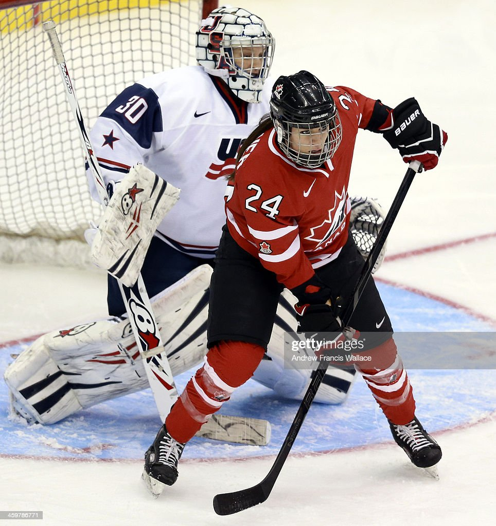 Canada's Spooner screens United States goalie Schaus in Women's Hockey