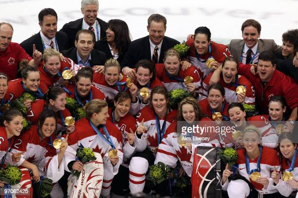 Team Canada pose with the gold medals won following their 2-0 victory during the ice hockey women's gold medal game between Canada and USA on day 14...
