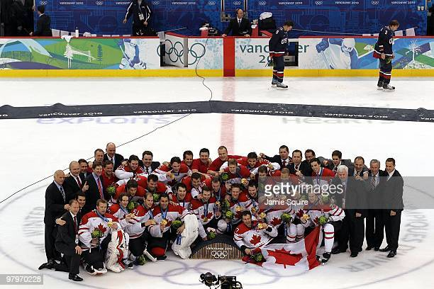 Team Canada poses for a team group photo with their gold medals after winning the ice hockey men's gold medal game against USA as Zach Parise and...