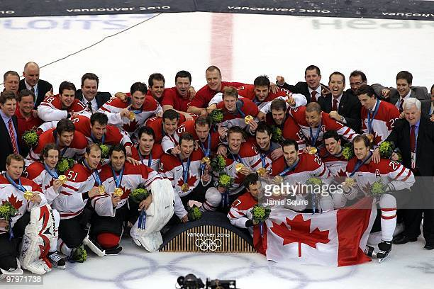 Team Canada poses for a team photo with their gold medals after winning the ice hockey men's gold medal game between USA and Canada on day 17 of the...
