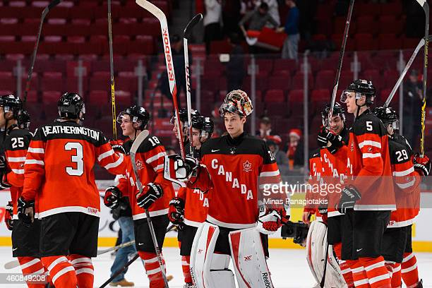 Team Canada raises their sticks in appreciation after their victory over Team Slovakia during the 2015 IIHF World Junior Hockey Championship game at...