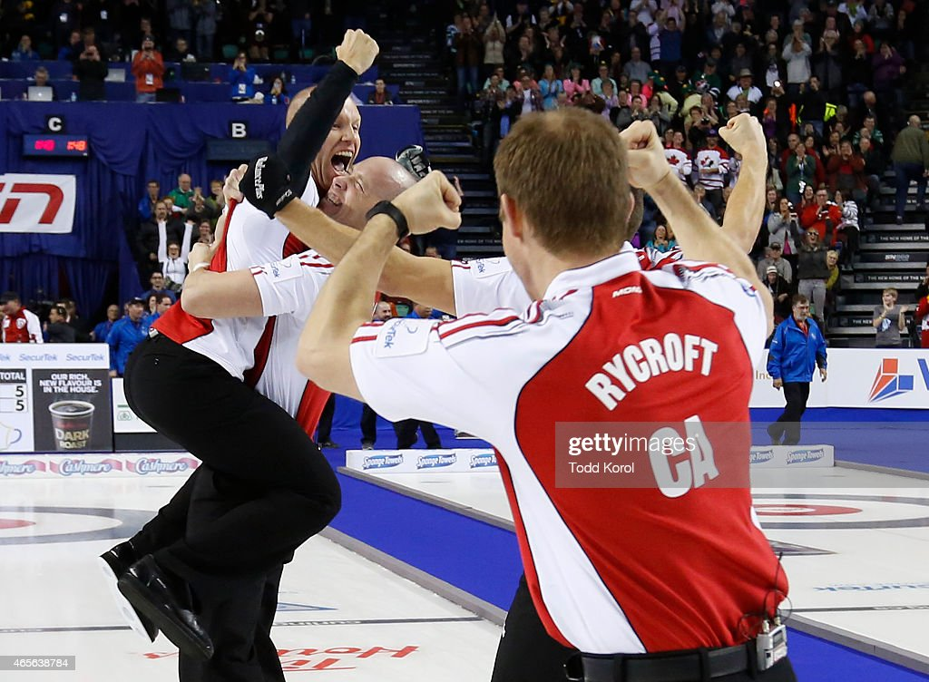Team Canada skip Pat Simmons (L) is hoisted into the air by lead Nolan Thiessen (C) while second Carter Rycroft celebrates after they defeated Northern Ontario in the gold medal game in curling during the Tim Horton's Brier at the Scotiabank Saddledome on March 8, 2015 in Calgary, Alberta, Canada.