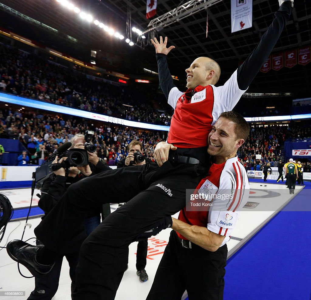 Team Canada skip Pat Simmons (L) is hoisted into the air by third John Morris after they defeated Northern Ontario in the gold medal game in curling during the Tim Horton's Brier at the Scotiabank Saddledome on March 8, 2015 in Calgary, Alberta, Canada.