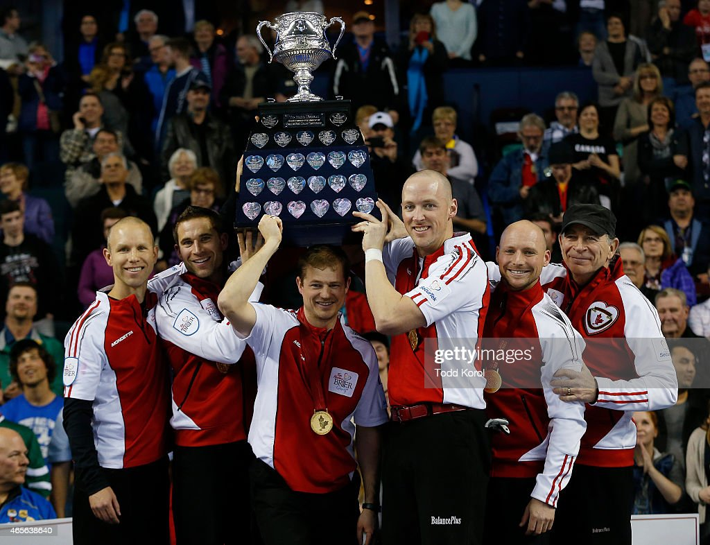 Team Canada skip Pat Simmons (L-R) third John Morris, second Carter Rycroft, lead Nolan Thiessen, alternate Tom Sallows and coach Earl Morris hoist the Tankard trophy after they defeated Northern Ontario in the gold medal game in curling during the Tim Horton's Brier at the Scotiabank Saddledome on March 8, 2015 in Calgary, Alberta, Canada.
