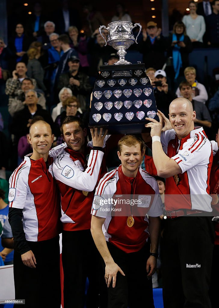 Team Canada skip Pat Simmons (L-R) third John Morris, second Carter Rycroft and lead Nolan Thiessen hoist the Tankard trophy after they defeated Northern Ontario in the gold medal game in curling during the Tim Horton's Brier at the Scotiabank Saddledome on March 8, 2015 in Calgary, Alberta, Canada.