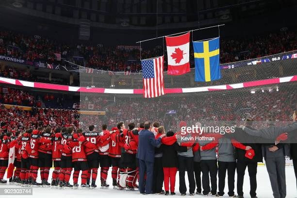 Team Canada stands together for the national anthem after the Gold medal game against Sweden of the IIHF World Junior Championship at KeyBank Center...