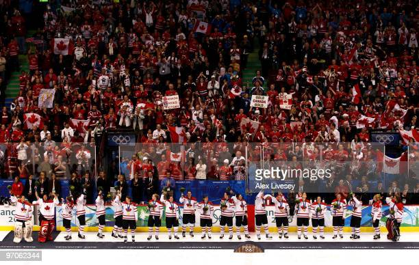 Team Canada wave to the crowd after receiving their gold medals in the medal ceremony following the ice hockey women's gold medal game between Canada...