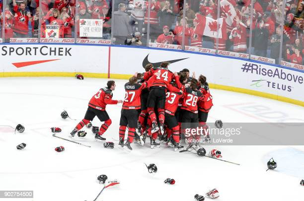 Team Cananda celebrates a 31 victory over Sweden following the third period of play in the IIHF World Junior Championships Gold Medal game at KeyBank...