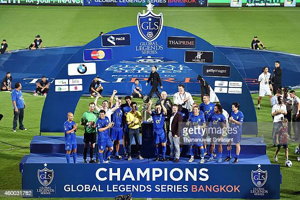 Team Cannavaro and Fabio Cannavaro celebrate with trophy on stage after the Global Legends Series match at the SCG Stadium on December 5 2014 in...