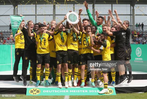 Team captain Alaa Bakir and his teammates of Borussia Dortmund celebrate after winning the B Juniors German Championship final match between FC...