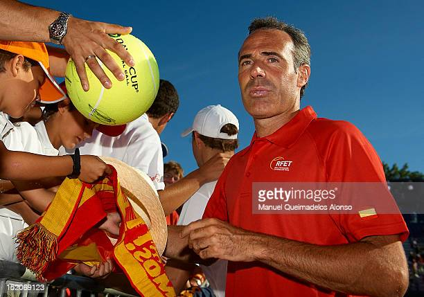 Team captain Alex Corretja of Spain signs autographs for fans after day two of the semi final Davis Cup between Spain and the United States at the...