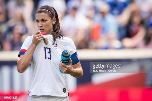 Team Captain Alex Morgan of United States takes a moment after a possible injury during the International Friendly match the US Women's National Team...