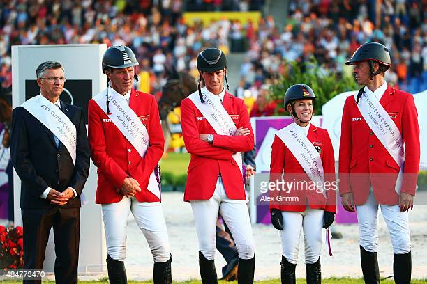 Team captain and Otto Becker Ludger Beerbaum Daniel Deusser Meredith MichaelsBeerbaum and Christian Ahlmann of Germany react after finishing second...