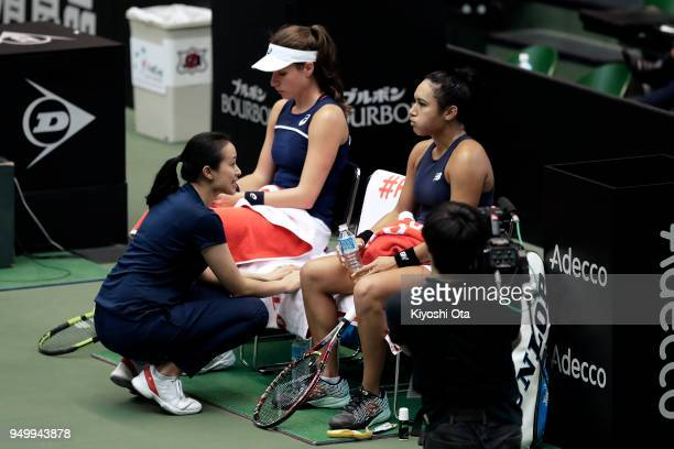 Team captain Anne Keothavong of Great Britain talks to Johanna Konta and Heather Watson of Great Britain in their doubles match against Miyu Kato and...