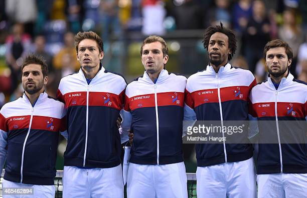 Team captain Arnaud Clement Nicolas Mahut Julien Benneteau Gael Monfils and Gilles Simon of France sing the national anthem at the opening ceremony...