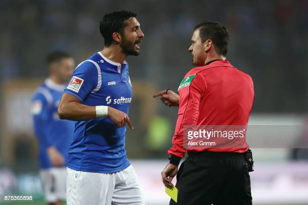 Team captain Aytac Sulu of Darmstadt disusses with referee Christian Dietz during the Second Bundesliga match between SV Darmstadt 98 and SV...