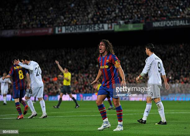 Team captain Carles Puyol of FC Barcelona reacts during the La Liga match between Barcelona and Real Madrid at the Camp Nou Stadium on November 29...