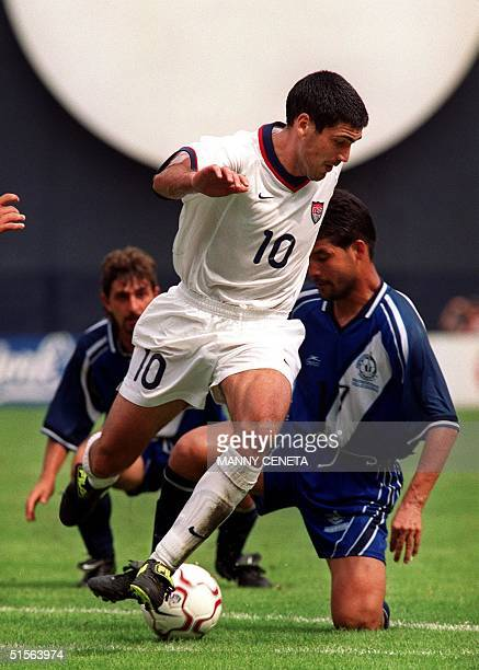 Team captain Claudio Reyna of the US loses the ball as he is tackled by Guatemala's German Ruano during their fourth round soccer World Cup...
