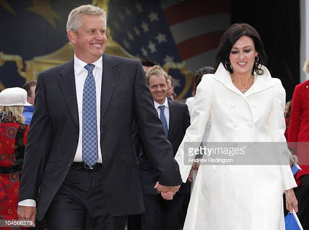 Team Captain Colin Montgomerie of Europe and Wife Gaynor lead out the players and their wives and girlfriends during the Opening Ceremony prior to...