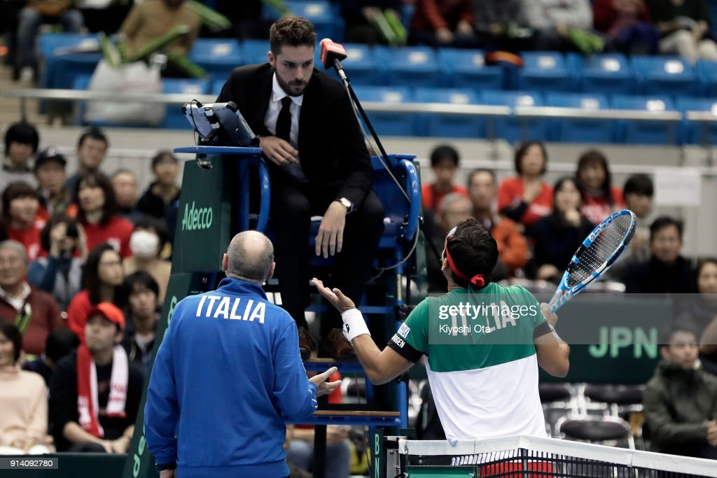 Team captain Corrado Barazzutti (bottom L) and Fabio Fognini (bottom R) of Italy argue with the chair umpire in his singles match against Yuichi Sugita of Japan during day three of the Davis Cup World Group first round between Japan and Italy at Morioka Takaya Arena on February 4, 2018 in Morioka, Iwate, Japan.