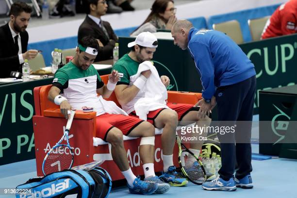 Team captain Corrado Barazzutti of Italy talks to Fabio Fognini and Simone Bolelli of Italy in their doubles match against Ben McLachlan and Yasutaka...