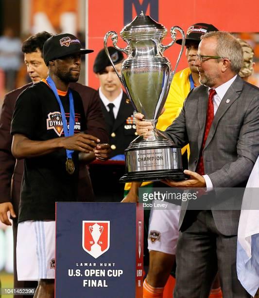 Team Captain DaMarcus Beasley of Houston Dynamo receives the Lamar Hunt U.S. Open Cup trophy as the Houston Dynamo defeated the Philadelphia Union...