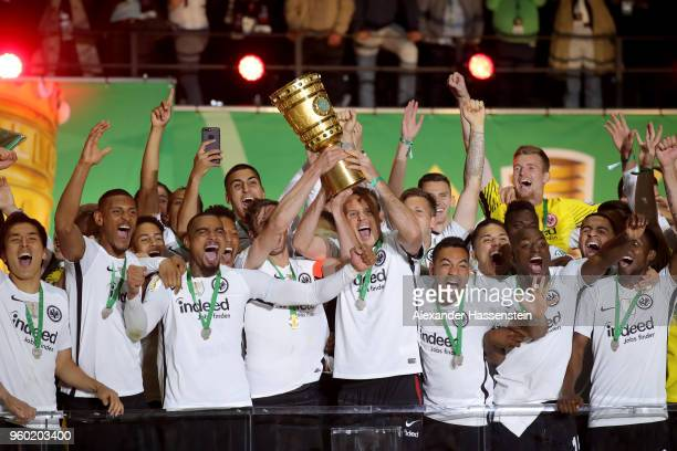 Team Captain David Abraham of Eintracht Frankfurt lifts the DFB Cup trophy after winning the DFB Cup final against Bayern Muenchen at Olympiastadion...