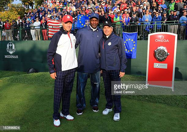 Team captain Davis Love III poses with Michael Jordan and Fred Couples on the first tee during the Morning Foursome Matches for The 39th Ryder Cup at...