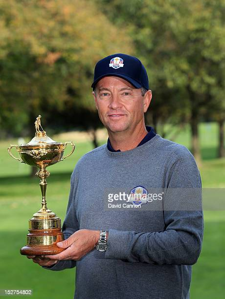 USA team captain Davis Love III poses with the trophy during the official photocall during the second preview day of The 39th Ryder Cup at Medinah...