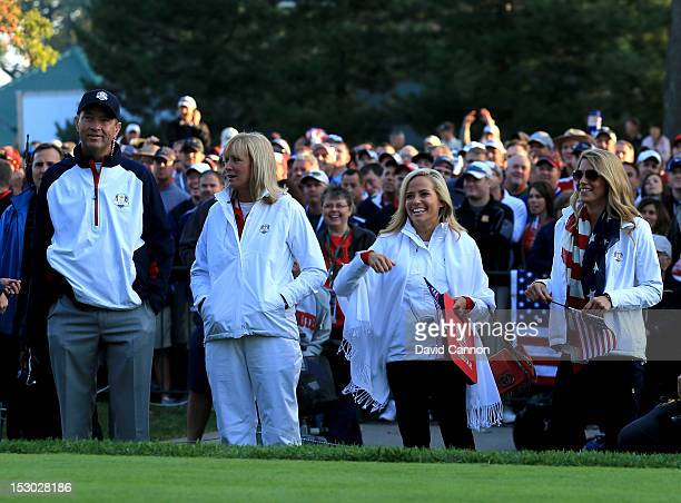 Team captain Davis Love III waits on the first tee with his wife Robin Amy Mickelson and Jillian Stacey during day two of the Morning Foursome...