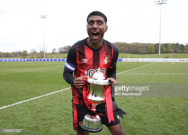 Team captain Dinesh Gillela of Bournemouth celebrates with the cup at the end of the match at St Georges Park on April 28, 2021 in Burton-upon-Trent,...