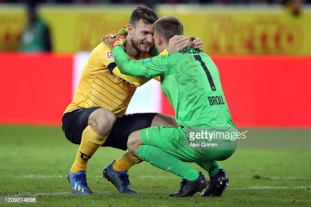 Team captain Florian Ballas and goalkeeper Kevin Broll of Dresden celebrate during the Second Bundesliga match between SSV Jahn Regensburg and SG...
