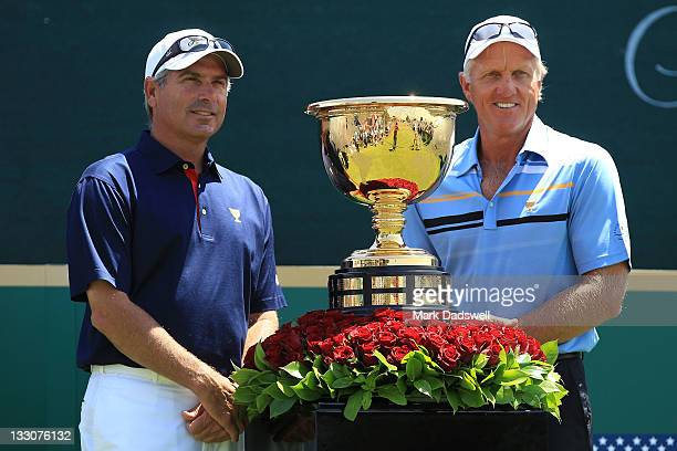 US Team captain Fred Couples and International Team captain Greg Norman stand alongside the Presidents Cup prior to the start of the Day One Foursome...