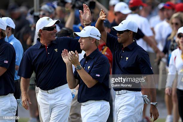 S Team captain Fred Couples celebrates on the 18th hole with his team players Tiger Woods and David Toms during the Day One Foursome Matches of the...