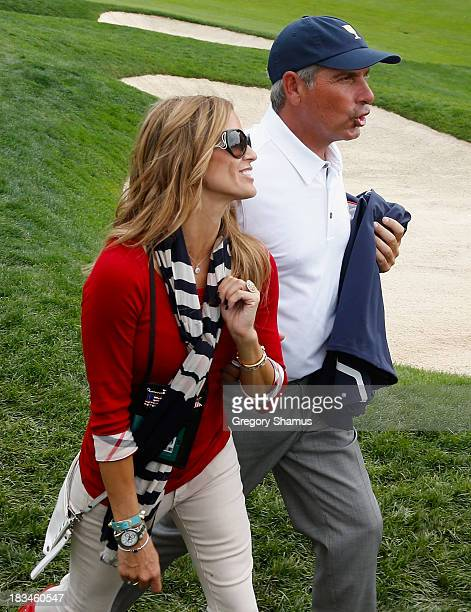S Team Captain Fred Couples walks off the 18th green with his girlfriend Nadine Moze after the US Team defeated the International Team 185 to 155...