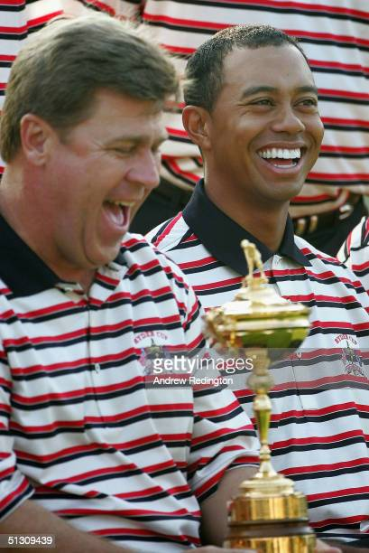 Team Captain Hal Sutton poses with the Ryder Cup and Tiger Woods during the USA official team photocall for the 35th Ryder Cup Matches at the Oakland...