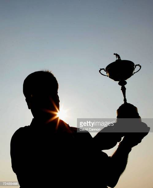 Team captain Hal Sutton with the trophy during the official team group photocall for the 35th Ryder Cup Matches at the Oakland Hills Country Club on...