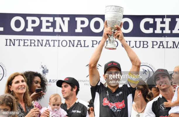 Team Captain Hilario Ulloa of The Daily Racing Form holds up the US Open trophy after leading his team to victory during the US Open Polo...