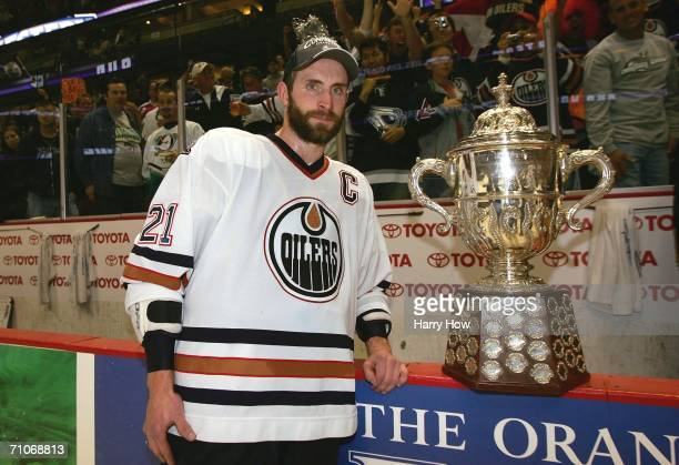 Team captain Jason Smith of the Edmonton Oilers poses with the Clarence S Campbell Bowl awarded to the Western Conference playoff champions after the...