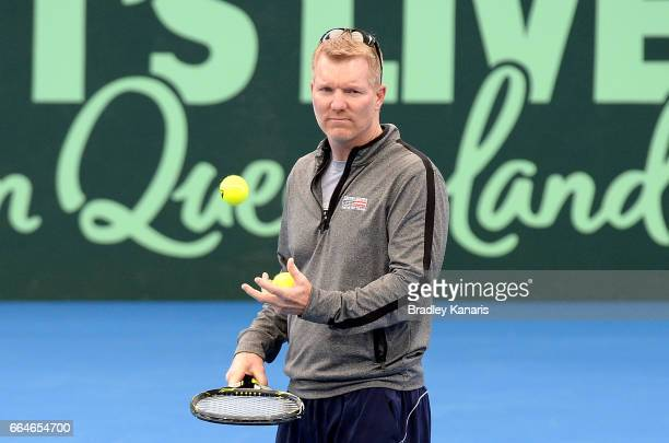 Team Captain Jim Courier of the USA watches on during practice ahead of the Davis Cup World Group Quarterfinal match between Australia and the USA at...