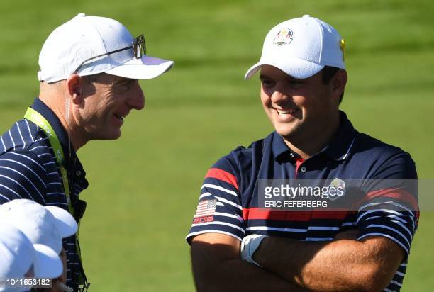 US team captain Jim Furyk speaks with US golfer Patrick Reed during a practice session ahead of the 42nd Ryder Cup at Le Golf National Course at...