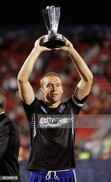 Team captain Jimmy Conrad holds the winners trophy during the 2008 Pepsi MLS All Star Game between the MLS All Stars and West Ham United at BMO Field...