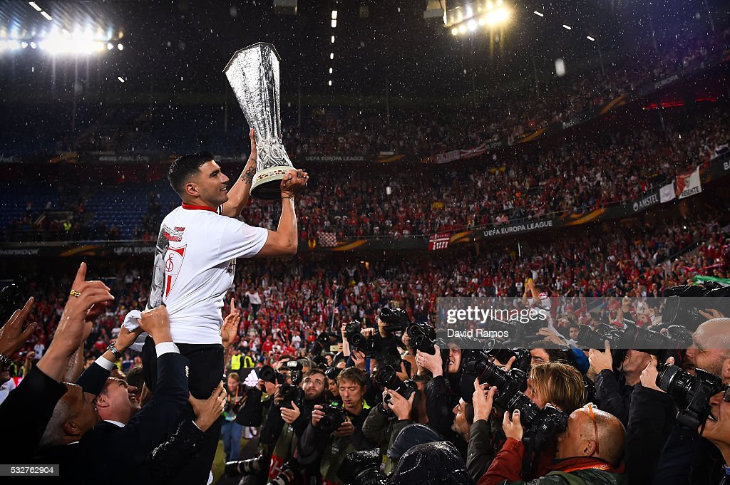 Team captain Jose Antonio Reyes of Sevilla FC poses for photographers with the trophy after the UEFA Europa League Final matach between Liverpool and Sevilla at St. Jakob-Park on May 18, 2016 in Basel, Basel-Stadt.