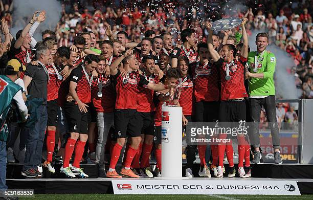 Team captain Julian Schuster of Freiburg presents the trophy for the second Bundesliga champion after the second Bundesliga match between SC Freiburg...